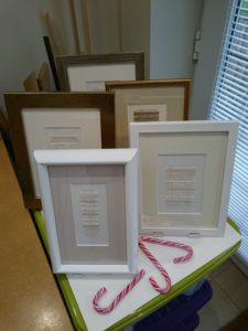 Framed Christmas presents waiting for a home.