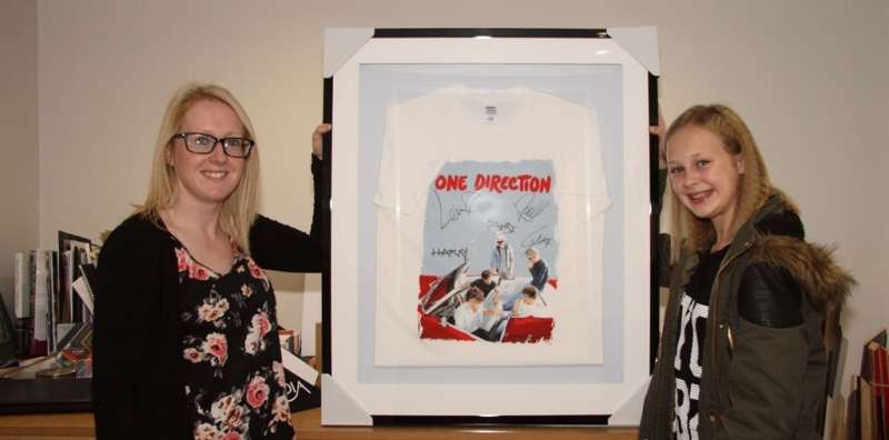 Paige shows off her framed One Direction T-shirt