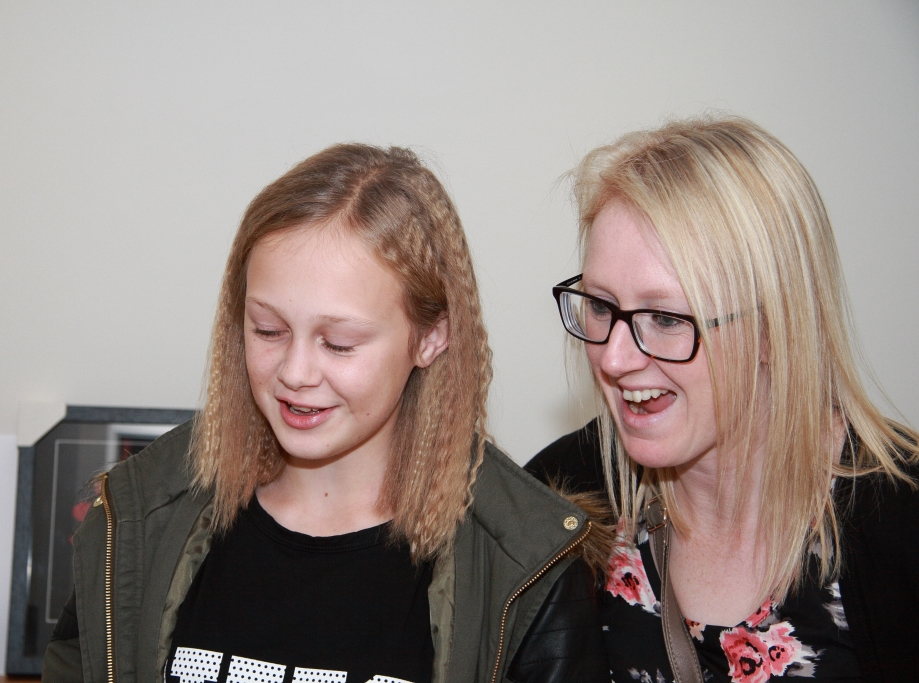 Paige and her Mum see for the first time her framed One Direction T-shirt .